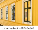 row of windows on a wooden house | Shutterstock . vector #682426762