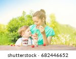 mother and her son child boy... | Shutterstock . vector #682446652