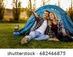shot of a happy couple camping... | Shutterstock . vector #682466875
