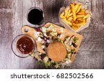 home made burgers on wooden...   Shutterstock . vector #682502566