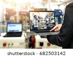 engineer hand using laptop with ... | Shutterstock . vector #682503142