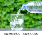 pour clean water in a glass of... | Shutterstock . vector #682527805