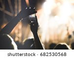 crowd with raised hands at...   Shutterstock . vector #682530568