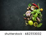 herbs and spices on black stone ... | Shutterstock . vector #682553032