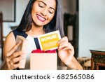 a happy young indian woman... | Shutterstock . vector #682565086