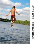 boy jumping into the water | Shutterstock . vector #68256619