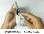 hand counting money | Shutterstock . vector #682574632