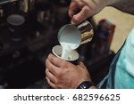 a barista pours steamed milk in ...   Shutterstock . vector #682596625