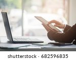 a business woman analyzing... | Shutterstock . vector #682596835