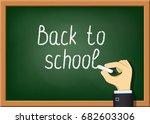 teacher is writing chalk on the ... | Shutterstock .eps vector #682603306