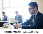 busy entrepreneur typing and... | Shutterstock . vector #682636642