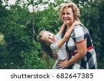 grandaughter hugging... | Shutterstock . vector #682647385