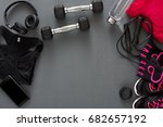 Female sport clothing and equipment top view, copy space. Set of new fitness outfit for women, active lifestyle, body care concept