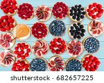 fruit and berry tartlets... | Shutterstock . vector #682657225