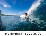 muscular surfer riding on big...   Shutterstock . vector #682668796