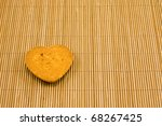 heart shaped cookie on striped bamboo  tablecloth - stock photo