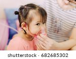 Small photo of Doctor treatment a child who got sick by a chest infection after a cold or the flu that has trouble breathing and prolonged cough.A symptom of asthma or pneumonia cause by respiratory syncytial virus.