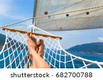 man's legs in a hammock on a... | Shutterstock . vector #682700788