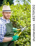 young gardener with a... | Shutterstock . vector #682709302