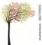 Autumn Tree With Falling Leaves
