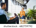 Stock photo cheerful coworkers chatting and waiting for lunch while on break from work in cafeteria 682759792