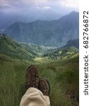 Small photo of Hiker's resting and contemplating alpine landscape