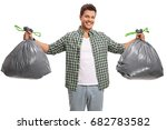 young guy with two bags of... | Shutterstock . vector #682783582