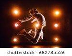 Young Man Break Dancer Jumping...
