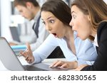 two surprised businesswomen... | Shutterstock . vector #682830565