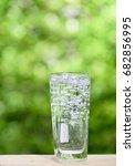 glass of splash water on wood... | Shutterstock . vector #682856995