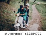 couple of hipster girls riding... | Shutterstock . vector #682884772