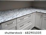 Stock photo close up on kitchen top and wood cabinet 682901035