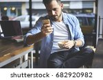 concentrated casually dressed... | Shutterstock . vector #682920982