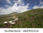 Small photo of Kyrgyzstan. Horses are grazed on a mountain pasture in the valley Suusamyr.Settlement of cattle breeders.Kyrgyzstan. Yurtas in which there live cattle breeders.