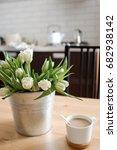 White Tulips In An Iron Vase ...