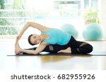 asian woman practicing yoga ... | Shutterstock . vector #682955926
