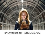 woman in the city at night... | Shutterstock . vector #683026702