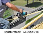roofer sawing  slats on a roof... | Shutterstock . vector #683056948