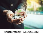 business man holding little... | Shutterstock . vector #683058382
