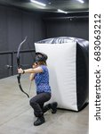 Small photo of Female with crossbow arrows bow. The Archer takes aim, sharpshooter. Crossbow club.