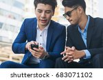 two business people discuss... | Shutterstock . vector #683071102