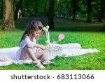 beautiful little girl in a park ... | Shutterstock . vector #683113066