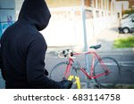 thief stealing a parked bike in ... | Shutterstock . vector #683114758