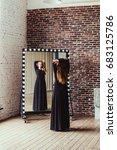 woman in black | Shutterstock . vector #683125786