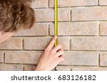 worker with roulette on beige... | Shutterstock . vector #683126182