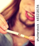Small photo of Young man breake down cigarette. Winning with addicted nicotine problems, stop smoking. Quitting from addiction concept.