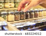 woman hand picking small jar of ... | Shutterstock . vector #683224012