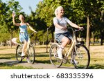 cheerful senior woman riding... | Shutterstock . vector #683335396