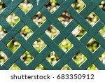Green Steel Fence On Backgroun...