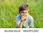 young boy exploring nature in... | Shutterstock . vector #683491282